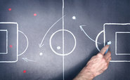 Football tactics drawn on a blackboard